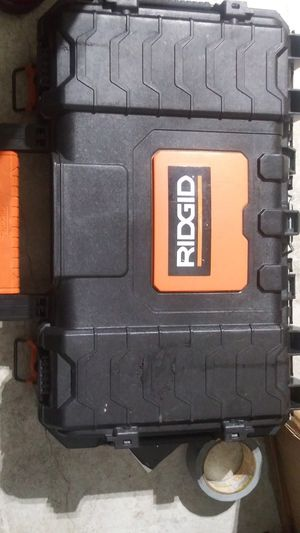 Ridgid drill set hammerdrill and impact drill with 2 4amps and charger for Sale in Olathe, KS