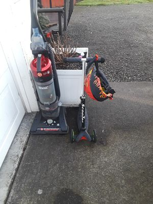FREE KIDS 3 WHEEL SCOOTER AND HELMET vaccume also free for Sale in Puyallup, WA