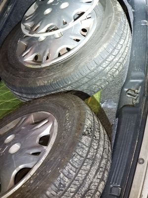 (2) NEW 185/70 R14 tires on 14x5 steel wheels 4x114.3mm lug + 3 hubcaps for Sale in Seattle, WA