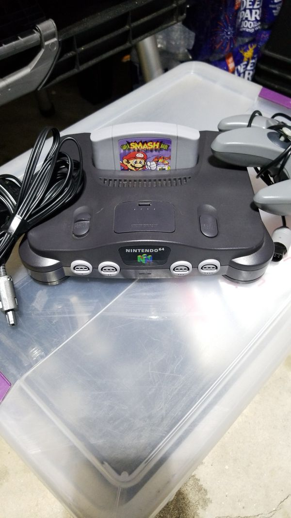 Nintendo 64 was Super Smash Bros one power cord one video cord One controller