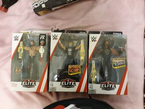 Wwe elete action figure shelid seth rollin, dean ambrose and roman renigs for Sale in Raleigh, NC