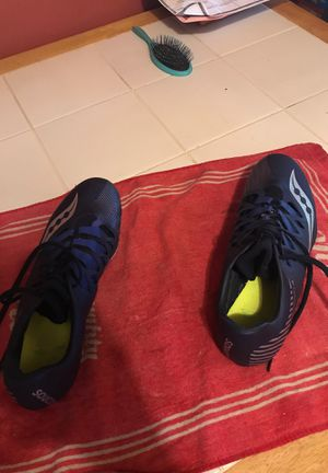 Good condition Saucony Track spikes/ with bag and spike tool size 11.5 for Sale in Benzonia, MI