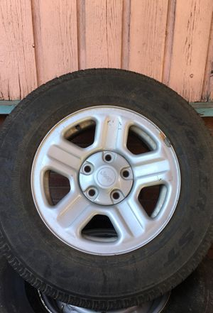Jeep five lug wheel and tire for Sale in Salt Lake City, UT