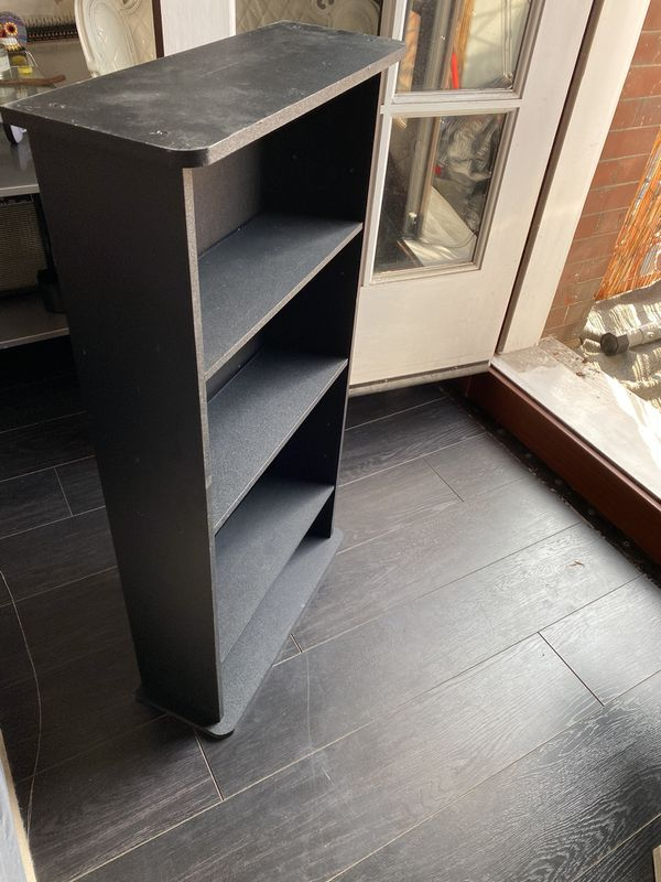 Small black shelf 3'hi 19 inches wide Shelves are 5 1/2 inches deep