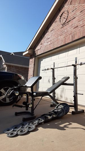 Bench press with lots of features comes with weights and bar for Sale in Saginaw, TX