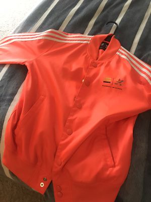Men's Pharrell adidas jacket...tangerine orange size men's small for Sale in Fairfax, VA