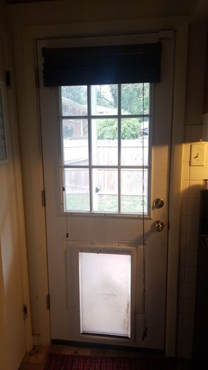 2868 RH jeldwen door slab with dog door for Sale in St. Louis, MO