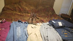 4 shirts ,4 pants ,and 1 pair of boots Womens FR clothes and boots look at photos for sizes and brand......... boots size 8-1/2 for Sale in Houston, TX