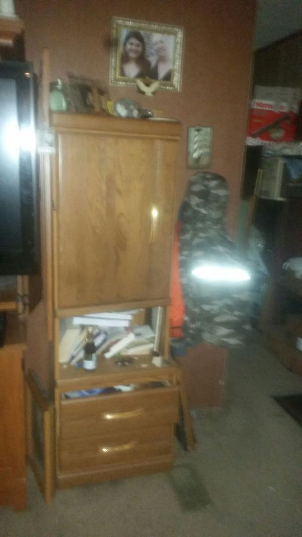 Cabinet with door and shelves and open storage and two big drawers. Nice compact and storage galore wooden cabinets . Two available.