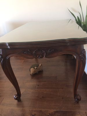 Beautiful antique dinner table. The table is in excellent condition. Heavy walnut wood. Has 6 chairs. However leather on chairs are not in good c for Sale in Laguna Beach, CA