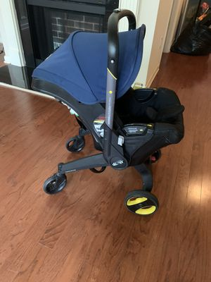 Doona car seat with base! (Original parts) for Sale in Atlanta, GA