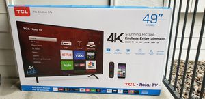 """TCL 49"""" (Model - 49S403) 4K UHD TV Roku smart TV with additional roku remote & wooden TV stand for Sale in Greenwood Village, CO"""