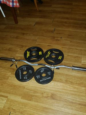 Gold gym and nautlius weights with bar for Sale in Roselle, IL