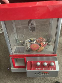 The Claw kids mini claw machine. Powered with fake or regular pennies. AA batteries included for Sale in Santa Monica,  CA