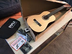 "Pyle 30 "" Classical acoustic guitar Linden Wood traditional style with the wood slat board case bag nylon strap tuner three pics great for beginners for Sale in Las Vegas, NV"