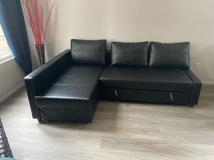 Leather sectional with sleeper for Sale in Riverside, CA