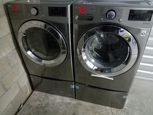 LG silver metalic washer gas dryer w pedestal for Sale in Tustin, CA