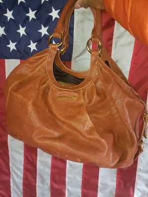 Miu miu leather hobo bag with original storage bag for Sale in Hilliard, OH