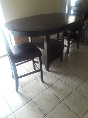Oval 60 in Pub dining table with 3 cushioned bar stools for Sale in Stone Mountain, GA