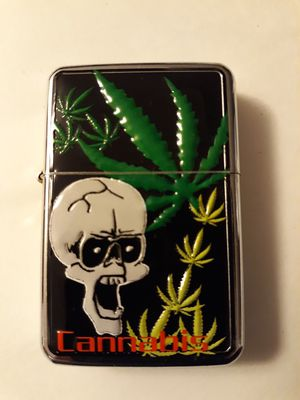 New etched cannabis skull and leads windproof oil lighter similar to zippo for Sale in Lancaster, OH