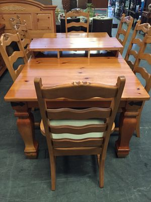Wood Table with 2 Leaves and 10 chairs for Sale in Sebring, FL
