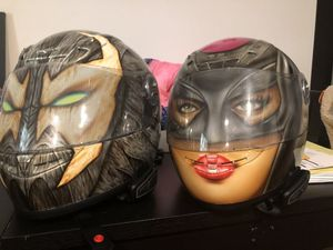 Custom painted motorcycle his an hers helmets for Sale in Bowie, MD