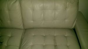 White couch that comes apart and makes a love seat as well as a bed for guests for Sale in Las Vegas, NV