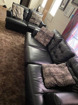 Black leather sofa and love seat with pollows included for Sale in Modesto, CA