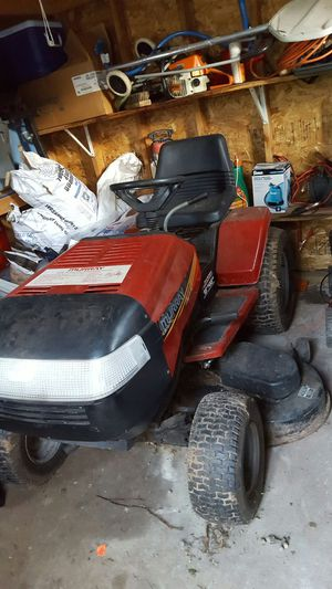 Ride on lawn mower, with snow plow attachment, needs battery charged or new for Sale in Edison, NJ