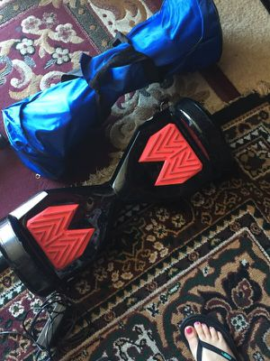 Hoverboard with charger and a bag for Sale in Kent, WA