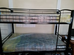 Black metal twin bunk beds. (Mattresses, still in plastic come with it.) for Sale in Eastman, GA