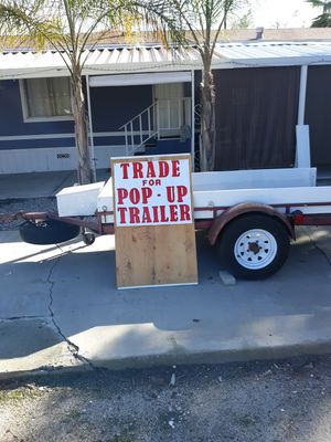 4x8 landa utility trailer, 2 ramps that store underneath, removable sideboards, several takedowns, toolbox, trailer Jack, new tires, for Sale in San Jacinto, CA