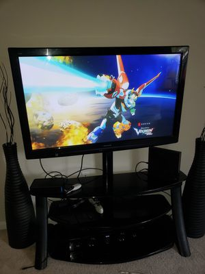 65inches tv with stand and side decorations for Sale in Germantown, MD