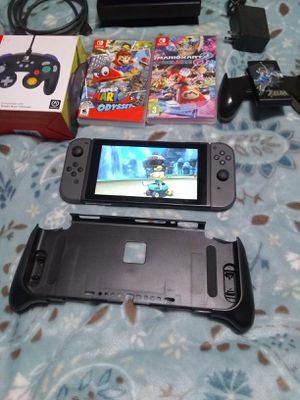 NINTENDO SWITCH with games and accesories NO LOWBALL OFFERS for Sale in San Marcos, CA