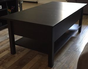 Gently used coffee table with extra leaf and game storage $50 for Sale in Livermore, CA