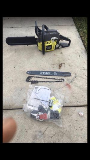 Powerful ryobi Chainsaw that come with extra blade and chain.. for Sale in Homestead, FL