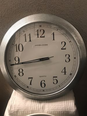 Two stylish wall clocks and glass candle holders... for Sale in Moapa, NV