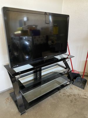 Phillips 50 inch tv with tv stand and tempered glass tv desk for Sale in El Cajon, CA