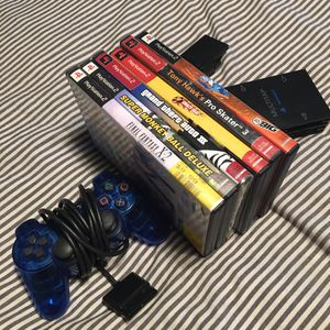 PS2 games and controller bundle. for Sale in San Bernardino, CA