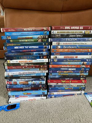 48 movies + extras and movie travel case and portable DVD player for Sale in Lincoln, RI