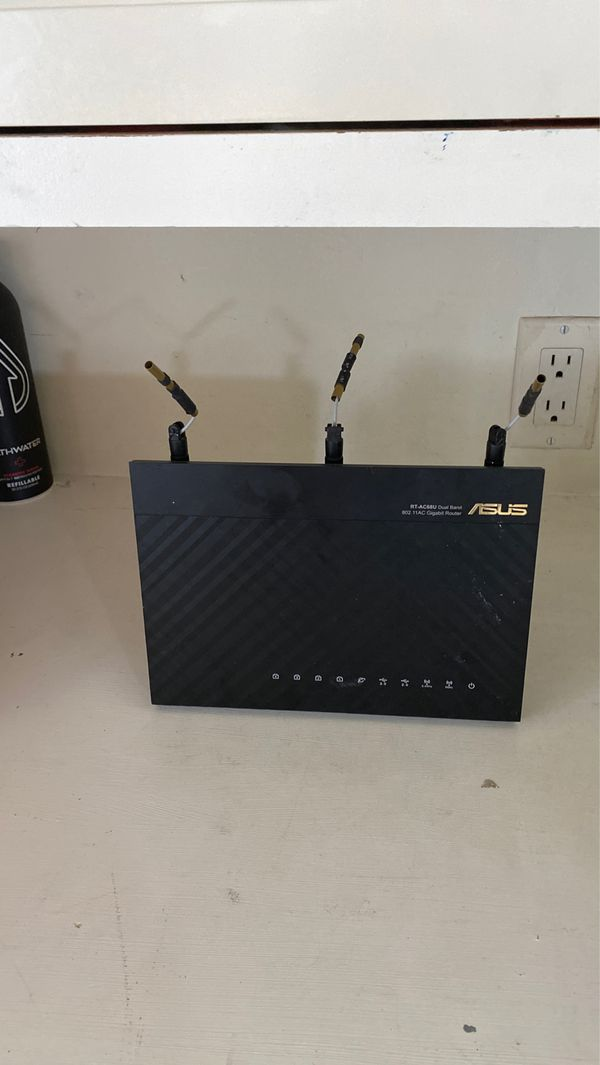ASUS DUAL BAND WIRELESS GIGABIT ROUTER. MODEL #: ASUS RT-AC68U AC1900 wireless gigabit router