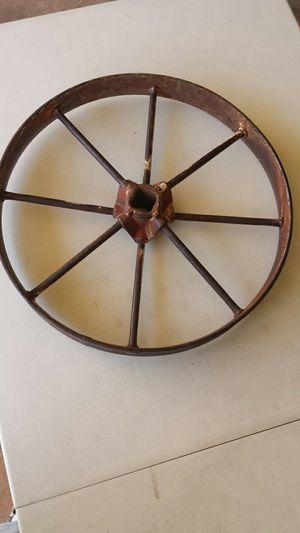 Rusty tractor wheel. for Sale in Sun City, AZ