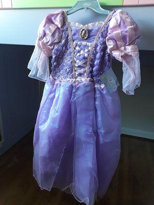 Original. Brand new Disney Store Princess Rapunzel Costume Dress. Size 7-8. $$45 price tag for Sale in Houston, TX