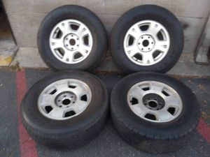Mismatched 17 inch aluminum Chevy rims with tires $50 each for Sale in Montebello, CA