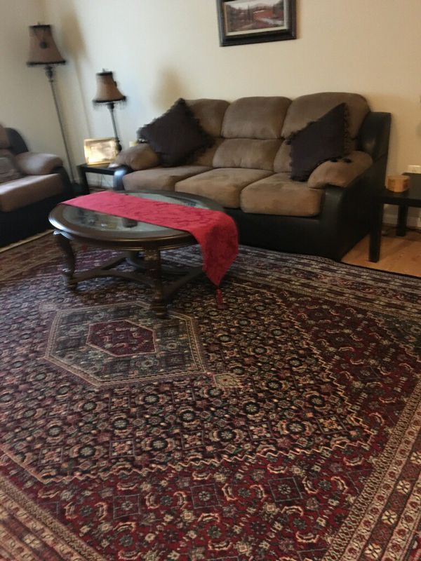 Samsung TV with stand, furniture, oriental rug