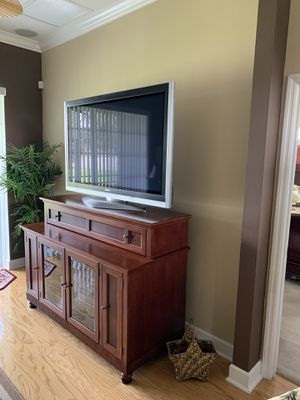 58 inch Panasonic Plasma TV, along with a brown television stand for Sale in Valrico, FL