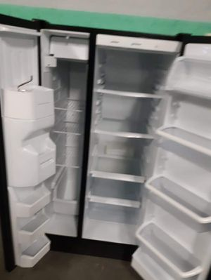 Whirlpool side by side doors fridge working perfectly for Sale in Baltimore, MD