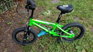 Childs Green Tony Hawk Bicycle with 2 Pegs onFront & Back - 12in Tires for Sale in Cayce, SC