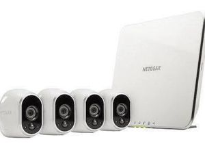 ARLO by Netgear wireless indoor/outdoor home security camera system with 4 cameras and base station for Sale in Hanford, CA