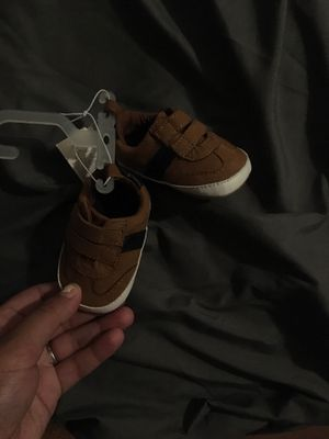 Shoes and a bag off size 2 diapers for Sale in Providence, RI